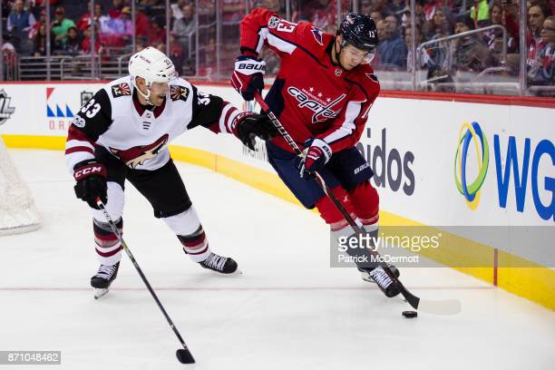 Jakub Vrana of the Washington Capitals skates with the puck against Alex Goligoski of the Arizona Coyotes in the first period at Capital One Arena on...