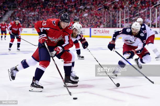 Jakub Vrana of the Washington Capitals skates with the puck against David Savard of the Columbus Blue Jackets in the third period in Game One of the...