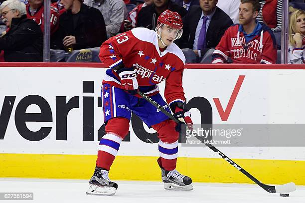 Jakub Vrana of the Washington Capitals skates with the puck in the first period during a NHL game against the New York Islanders at Verizon Center on...