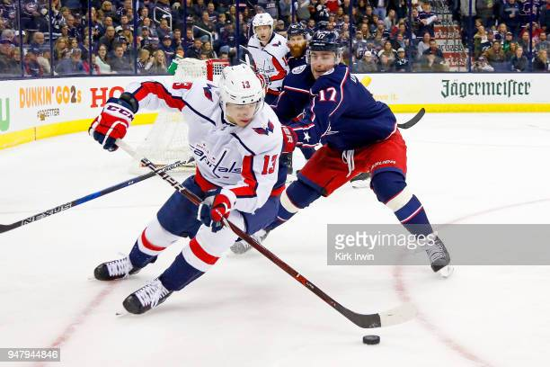 Jakub Vrana of the Washington Capitals steers the puck away from Brandon Dubinsky of the Columbus Blue Jackets during the third period in Game Three...
