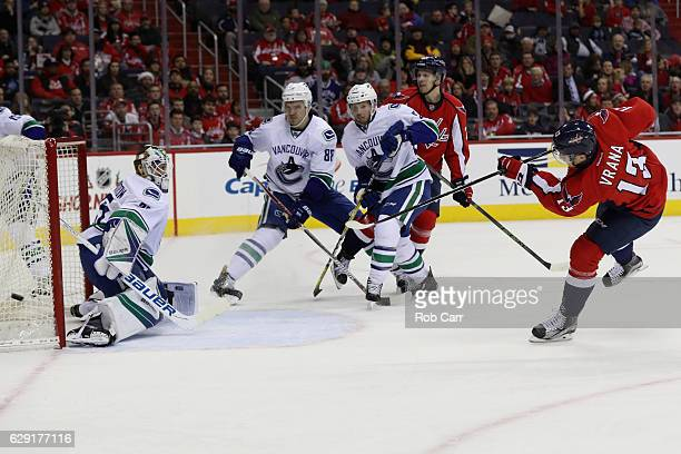 Jakub Vrana of the Washington Capitals takes a shot on goal against the Vancouver Canucks in the second period at Verizon Center on December 11 2016...