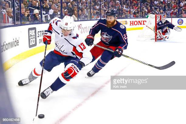 Jakub Vrana of the Washington Capitals turns the puck away from Ian Cole of the Columbus Blue Jackets during the first period in Game Six of the...
