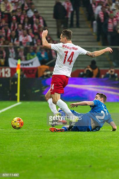 Jakub Wawrzyniak Birkir S��varsson during the friendly match between Poland and Iceland at the National Stadium on November 13 2015 in Warsaw Poland