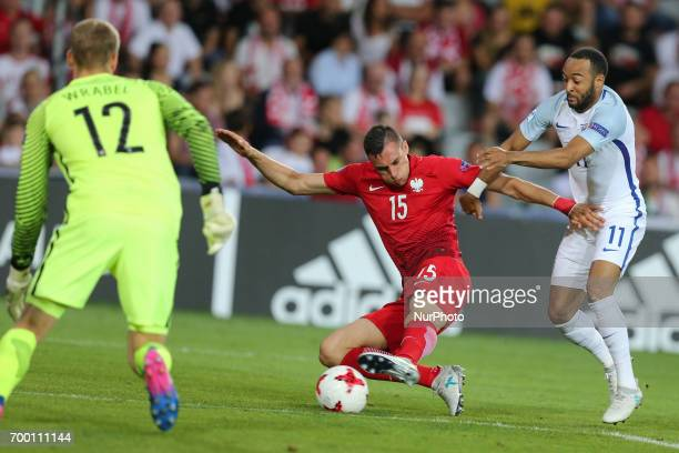 Jakub Wrabel Jaroslaw Jach Nathan Redmond during the UEFA European Under21 Championship Group A match between England and Poland at Kielce Stadium on...