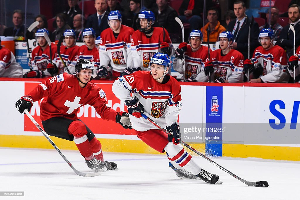 Jakub Zboril #20 of Team Czech Republic skates the puck against Loic In-Albon #16 of Team Switzerland during the IIHF World Junior Championship preliminary round game at the Bell Centre on December 27, 2016 in Montreal, Quebec, Canada.