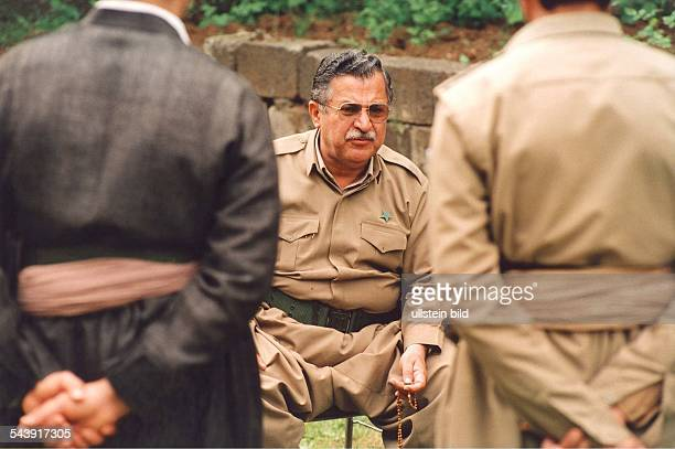 Jalal Talabani leader of the Patriotic Union of Kurdistan with bodyguards and in uniform in his headquarters