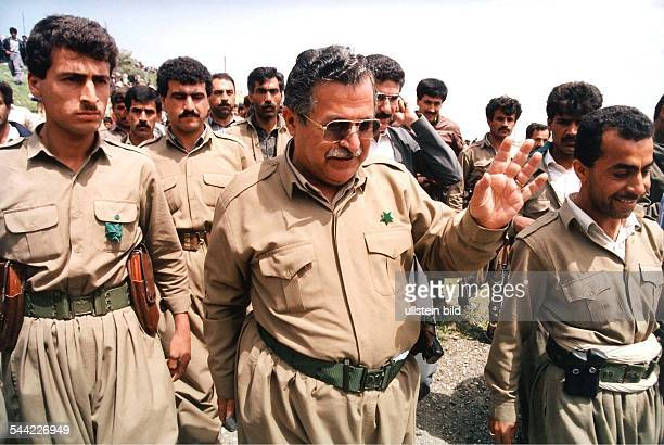 Jalal Talabani leader of the Patriotic Union of Kurdistan with bodyguards and in uniform