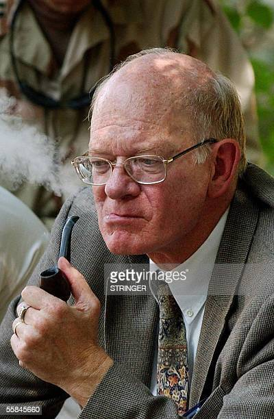 Jalalabad, AFGHANISTAN: U.S ambassador to Afghanistan Ronald E. Neumann smokes a pipe on the outskirts of the city Jalalabad in Nangarhar province...