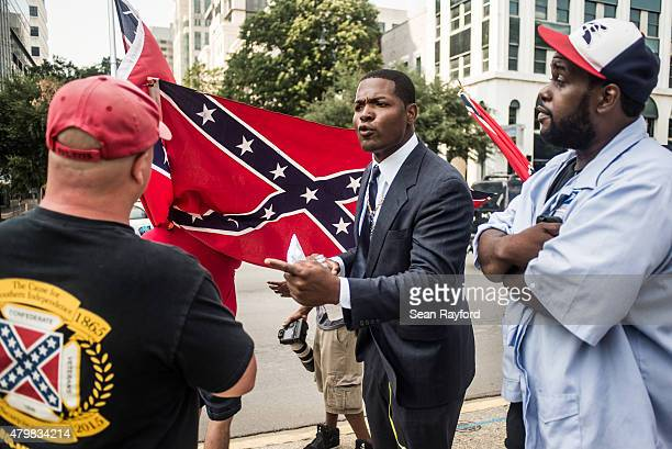 Jalaludin AbdulHamid talks to a Confederate flag supporter outside the South Carolina Statehouse July 7 2015 in Columbia South Carolina State...