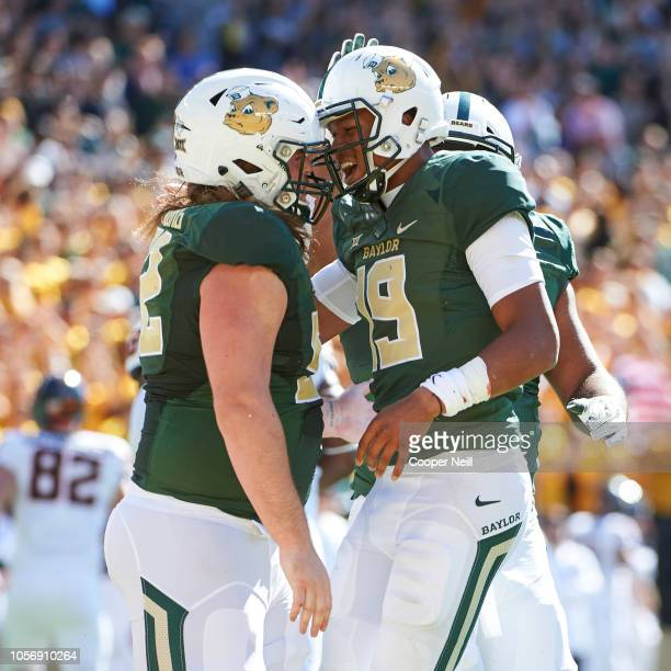 Jalan McClendon of the Baylor Bears celebrates after scoring on a 1 yard touchdown run with teammate Sam Tecklenburg against the Oklahoma State...