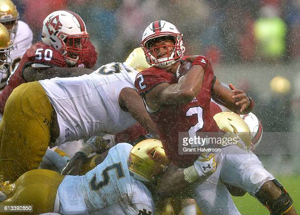Jalan McClendon of the North Carolina State Wolfpack runs the wildcat as Nyles Morgan of the Notre Dame Fighting Irish defends during the game at...