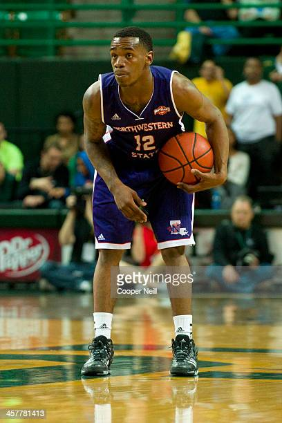 Jalan West of the Northwestern State Demons brings the ball up court against the Baylor Bears on December 18 2013 at the Ferrell Center in Waco Texas