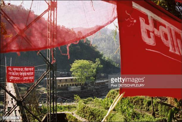 Jalbire The bridge crossing the Belephi river between rice plantations and the village Red banderole attached to the bridge Long Live commerade Suman...