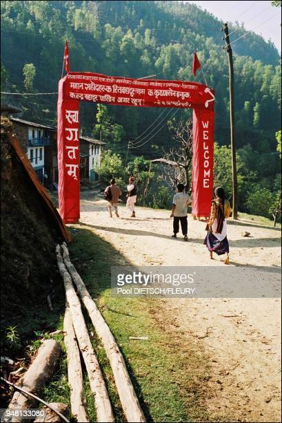 Jalbire Welcome porch in maoist territory On the banderole Labor's of the World unite Hail to marxism LeninismMaoism and Prachanda Path