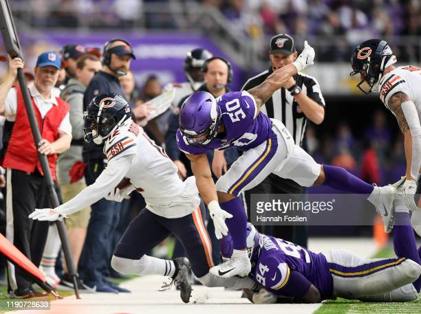 Jaleel Johnson and Eric Wilson of the Minnesota Vikings puts Allen Robinson of the Chicago Bears out of bounds during the second quarter of the game...