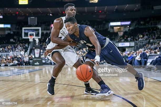 Jaleen Smith Guard for University of New Hampshire drives to the basket during the game between the Providence College Friars and the University of...