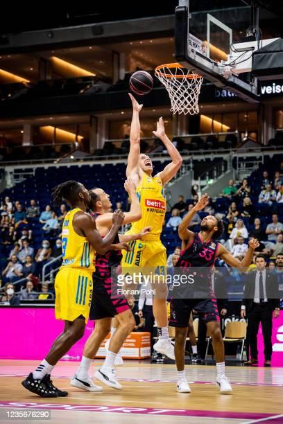 Jaleen Smith of Alba Berlin, Karsten Tadda of Telekom Baskets Bonn, Luke Sikma of Alba Berlin and Parker Jackson-Cartwright of Telekom Baskets Bonn...