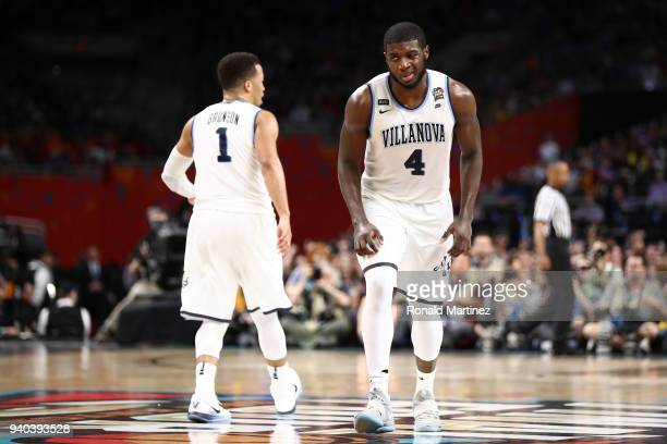 Jalen Brunson and Eric Paschall of the Villanova Wildcats react in the second half against the Kansas Jayhawks during the 2018 NCAA Men's Final Four...