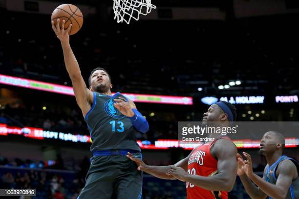 Jalen Brunson of the Dallas Mavericks shoots over Julius Randle of the New Orleans Pelicans during a NBA game at the Smoothie King Center on December...