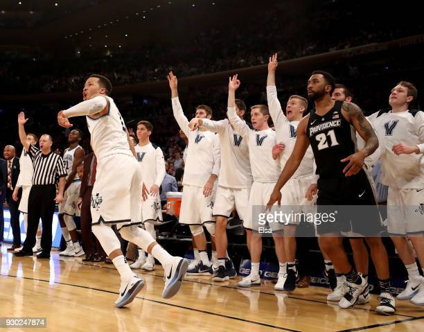 Jalen Brunson of the Villanova Wildcats and the bench celebrate his shot in the second half against the Providence Friars during the championship...