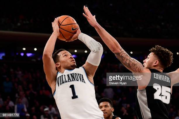 Jalen Brunson of the Villanova Wildcats attempts a jump shot against Drew Edwards of the Providence Friars during the championship game of the Big...