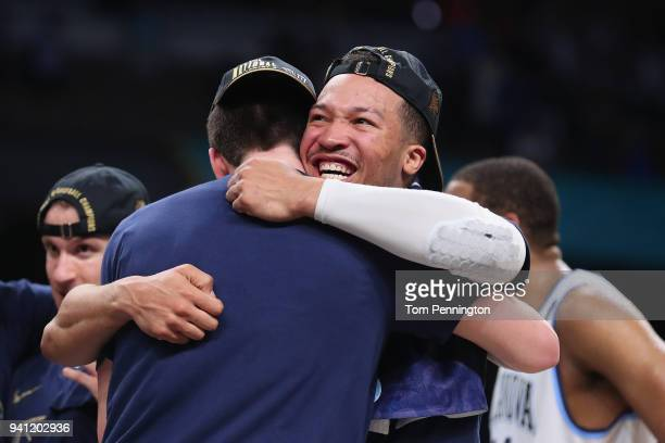 Jalen Brunson of the Villanova Wildcats celebrates with teammates after defeating the Michigan Wolverines during the 2018 NCAA Men's Final Four...