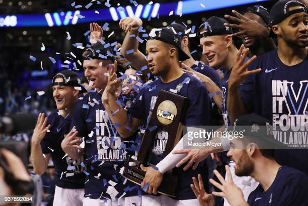 Jalen Brunson of the Villanova Wildcats celebrates with the East Regional Champion trophy after defeating the Texas Tech Red Raiders 7159 in the 2018...