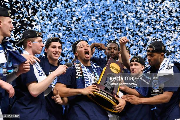 Jalen Brunson of the Villanova Wildcats celebrates with the trophy after the 2018 NCAA Photos via Getty Images Men's Final Four National Championship...
