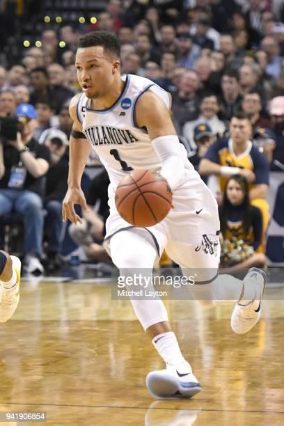Jalen Brunson of the Villanova Wildcats dribbles the ball during the 2018 NCAA Men's Basketball Tournament East Regional against the West Virginia...
