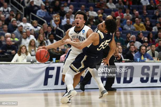 Jalen Brunson of the Villanova Wildcats drives against Elijah Long of the Mount St. Mary's Mountaineers as he draws the foul in the first half during...