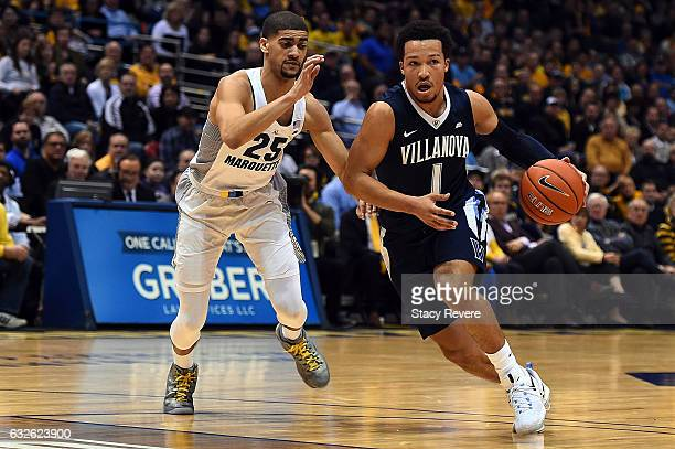 Jalen Brunson of the Villanova Wildcats drives around Haanif Cheatham of the Marquette Golden Eagles during the first half of a game at BMO Harris...
