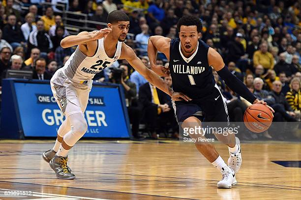 Jalen Brunson of the Villanova Wildcats drives around Haanif Cheatham of the Marquette Golden Eagles during a game at the BMO Harris Bradley Center...