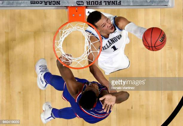 Jalen Brunson of the Villanova Wildcats drives to the basket against Silvio De Sousa of the Kansas Jayhawks during the 2018 NCAA Men's Final Four...