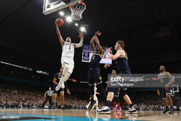 Jalen Brunson of the Villanova Wildcats drives to the basket against Charles Matthews of the Michigan Wolverines in the first half during the 2018...