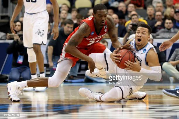 Jalen Brunson of the Villanova Wildcats fights for the ball against Ed Polite Jr #24 of the Radford Highlanders during the second half of the game in...