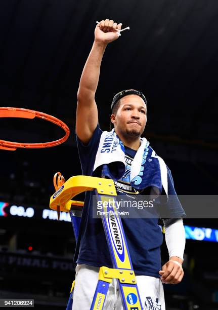 Jalen Brunson of the Villanova Wildcats holds a piece of the net after the 2018 NCAA Photos via Getty Images Men's Final Four National Championship...
