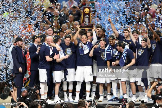 Jalen Brunson of the Villanova Wildcats holds the trophy after the 2018 NCAA Photos via Getty Images Men's Final Four National Championship game...