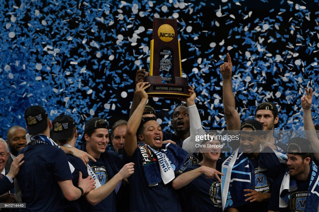 Jalen Brunson #1 of the Villanova Wildcats holds up the trophy after the 2018 NCAA Men's Final Four National Championship game against the Michigan Wolverines at the Alamodome on April 2, 2018 in San Antonio, Texas.