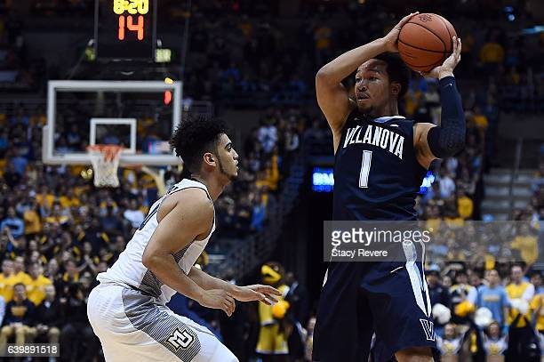 Jalen Brunson of the Villanova Wildcats is defended by Markus Howard of the Marquette Golden Eagles during a game at the BMO Harris Bradley Center on...