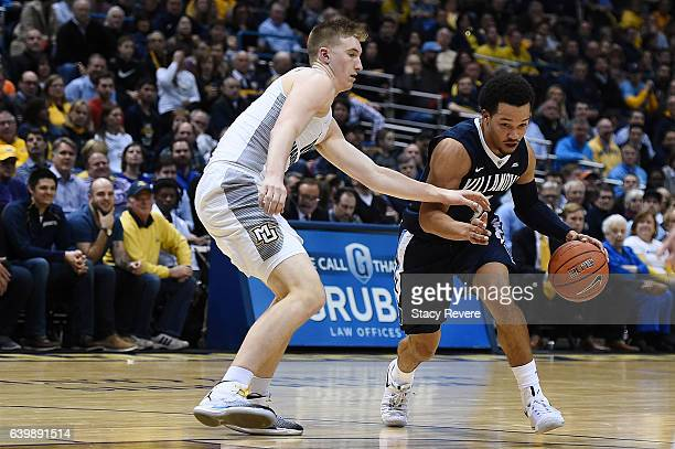 Jalen Brunson of the Villanova Wildcats is defended by Sam Hauser of the Marquette Golden Eagles during a game at the BMO Harris Bradley Center on...