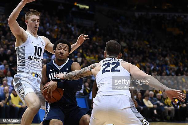 Jalen Brunson of the Villanova Wildcats is fouled by Katin Reinhardt of the Marquette Golden Eagles during the first half of a game at BMO Harris...