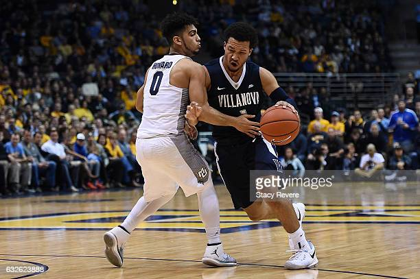Jalen Brunson of the Villanova Wildcats is fouled by Markus Howard of the Marquette Golden Eagles during the first half of a game at BMO Harris...