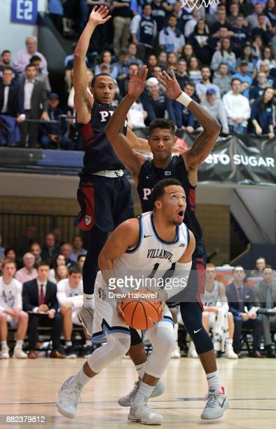 Jalen Brunson of the Villanova Wildcats looks to put up a shot against a defending Darnell Foreman and Eddie Scott of the Pennsylvania Quakers at...