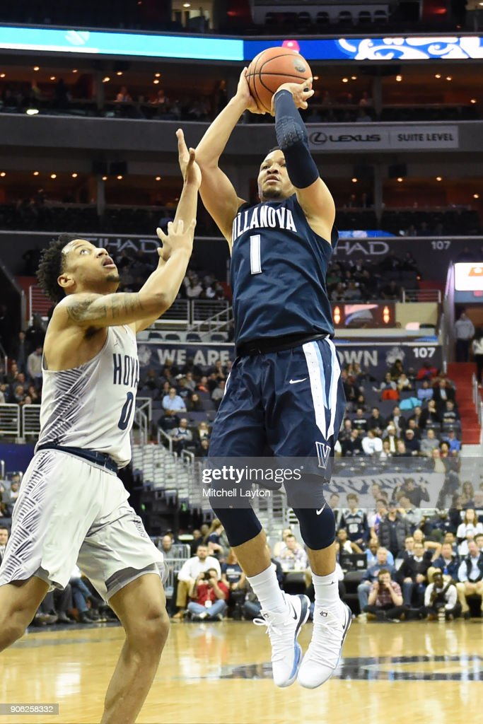 Jalen Brunson #1 of the Villanova Wildcats takes a jump shot over Jahvon Blair #0 of the Georgetown Hoyas during a college basketball game at the Capital One Arena on January 17, 2018 in Washington, DC.
