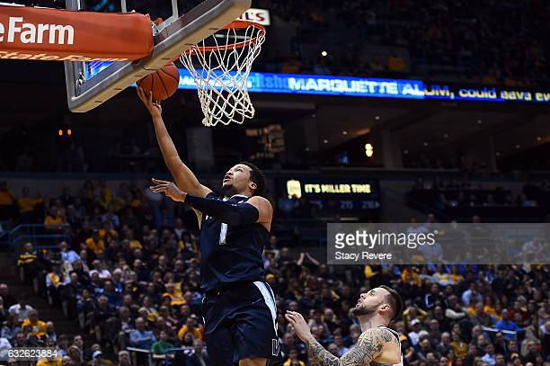 Jalen Brunson of the Villanova Wildcats takes a shot during the first half of a game against the Marquette Golden Eagles at BMO Harris Bradley Center...