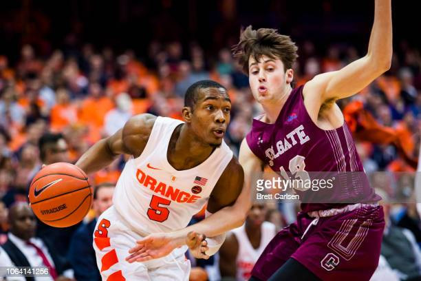 Jalen Carey of the Syracuse Orange drives to the basket against Jack Ferguson of the Colgate Raiders during the second half at the Carrier Dome on...