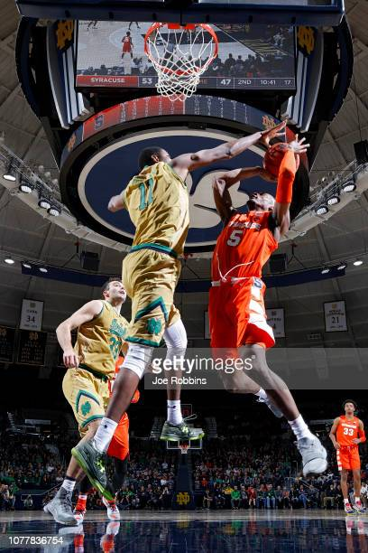 Jalen Carey of the Syracuse Orange goes to the basket against Juwan Durham of the Notre Dame Fighting Irish in the second half of the game at Purcell...