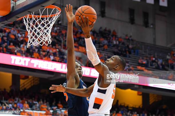 Jalen Carey of the Syracuse Orange shoots the ball as Mamadi Diakite of the Virginia Cavaliers defends during the second half at the Carrier Dome on...