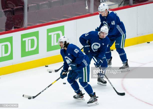 Jalen Chatfield,Quinn Hughes and Olli Juolevi of the Vancouver Canucks skate on the first day of the Vancouver Canucks NHL Training Camp on January...