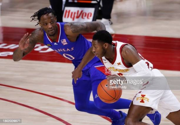 Jalen Coleman-Lands of the Iowa State Cyclones drives then ball as Marcus Garrett of the Kansas Jayhawks puts pressure on in the first half of play...